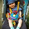 Dominic smiling in his pram with a nasogastric feeding tube