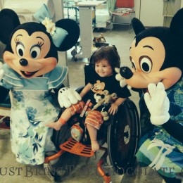 DOminic at Great Ormond street hospital with mickey mouse and Minnie Mouse